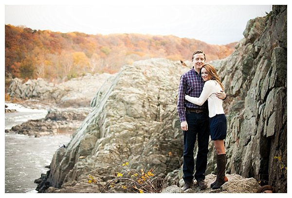 Engaged couple by river