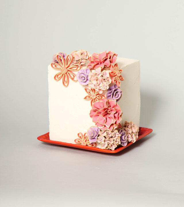 Pink, coral, orange, and violet fantasy flower cake