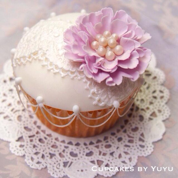 Fondant lace cupcakes with purple flower