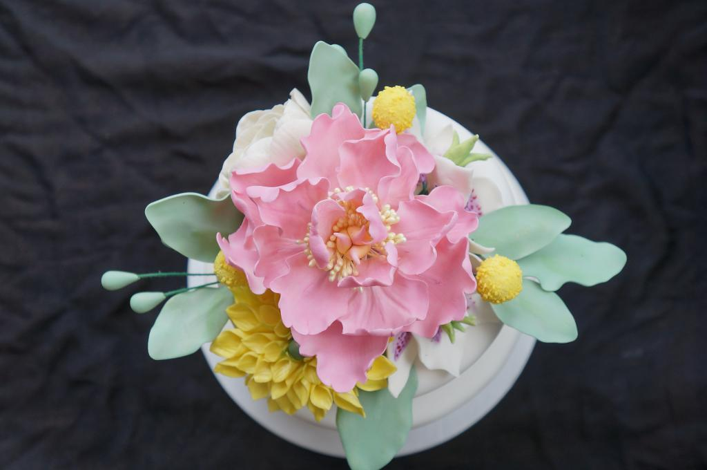 Sugar flower cake with perfect green foliage