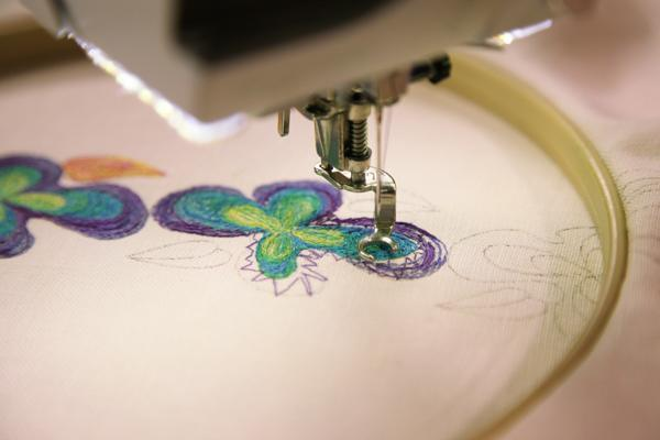 free hand machine embroidery of purple and green flowers