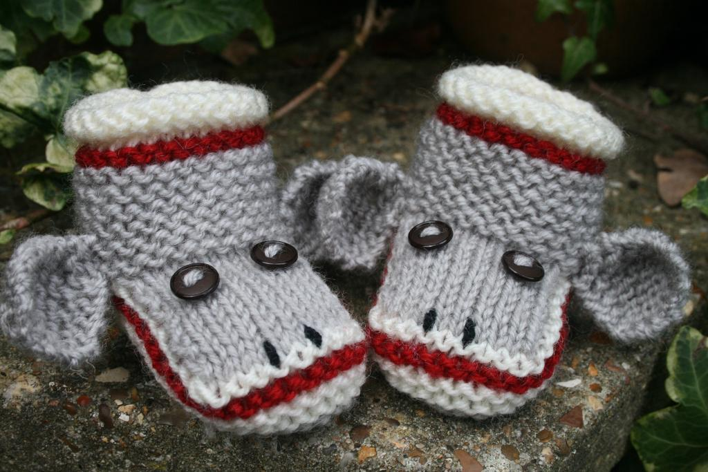 Knitted sock monkey baby booties