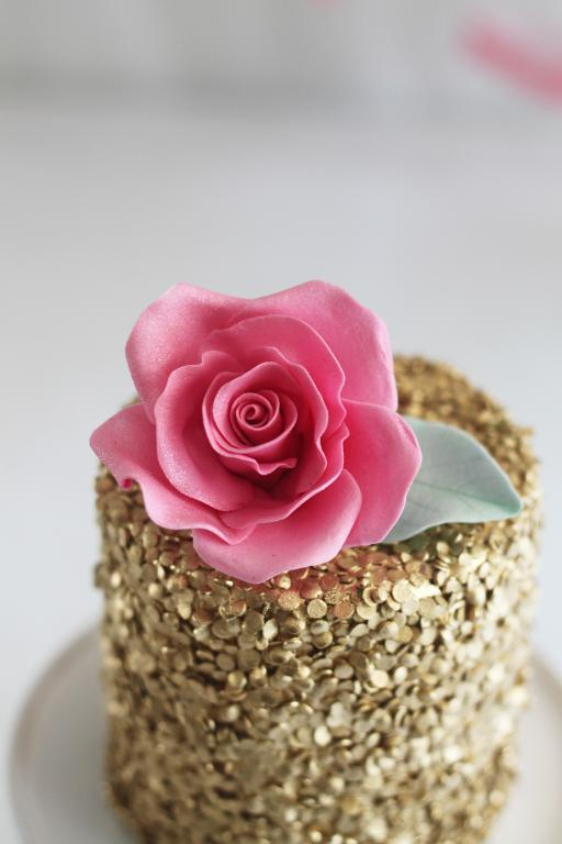 Gold sequins cake with a perfect pink sugar rose