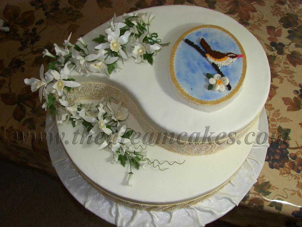 Amazingly intricate quilled bird cake