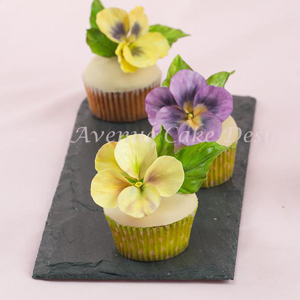 Beautiful cupcakes toped with sugar pansies
