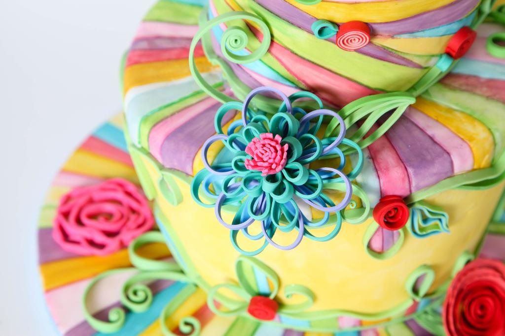 Beautiful swirling rainbow quilled cake
