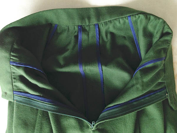 Using Bias Tape To Finish Seams on a Green Knit Sweater
