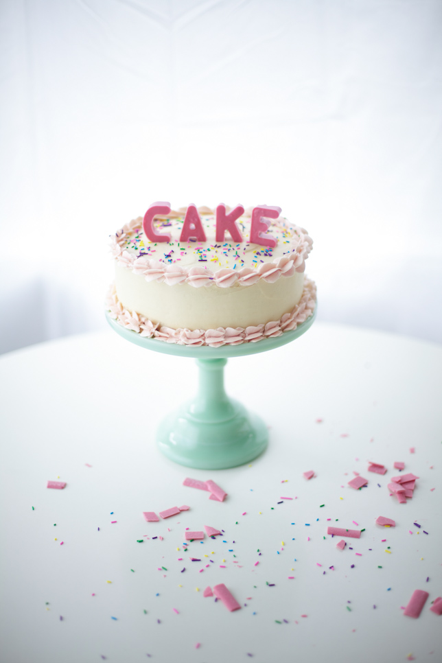 Layer cake with pink edible block letters