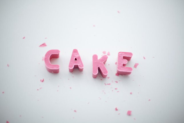 C-A-K-E pink edible letters