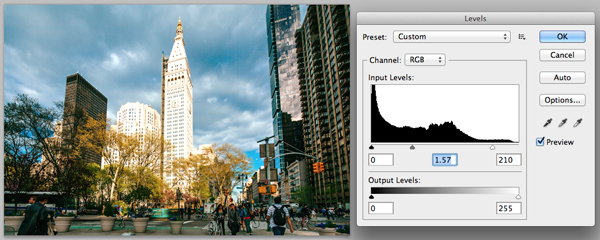 Adjusting levels of the city scene in Photoshop