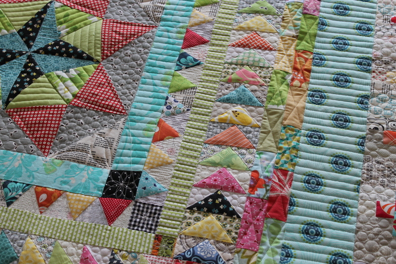 Colorful patchwork quilt with scrap quilt border