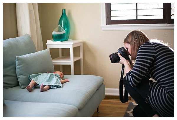 photographer taking photo of newborn