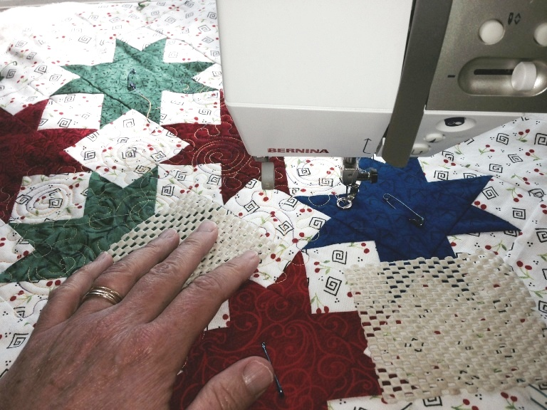 Sticky Squares to Stabilize Quilt