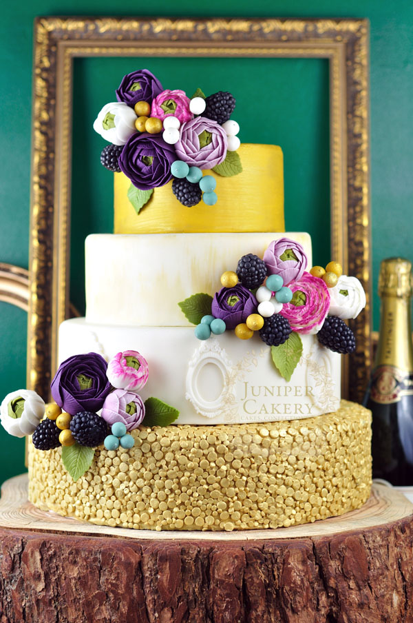 Bright ranunculus wedding cake by Juniper Cakery