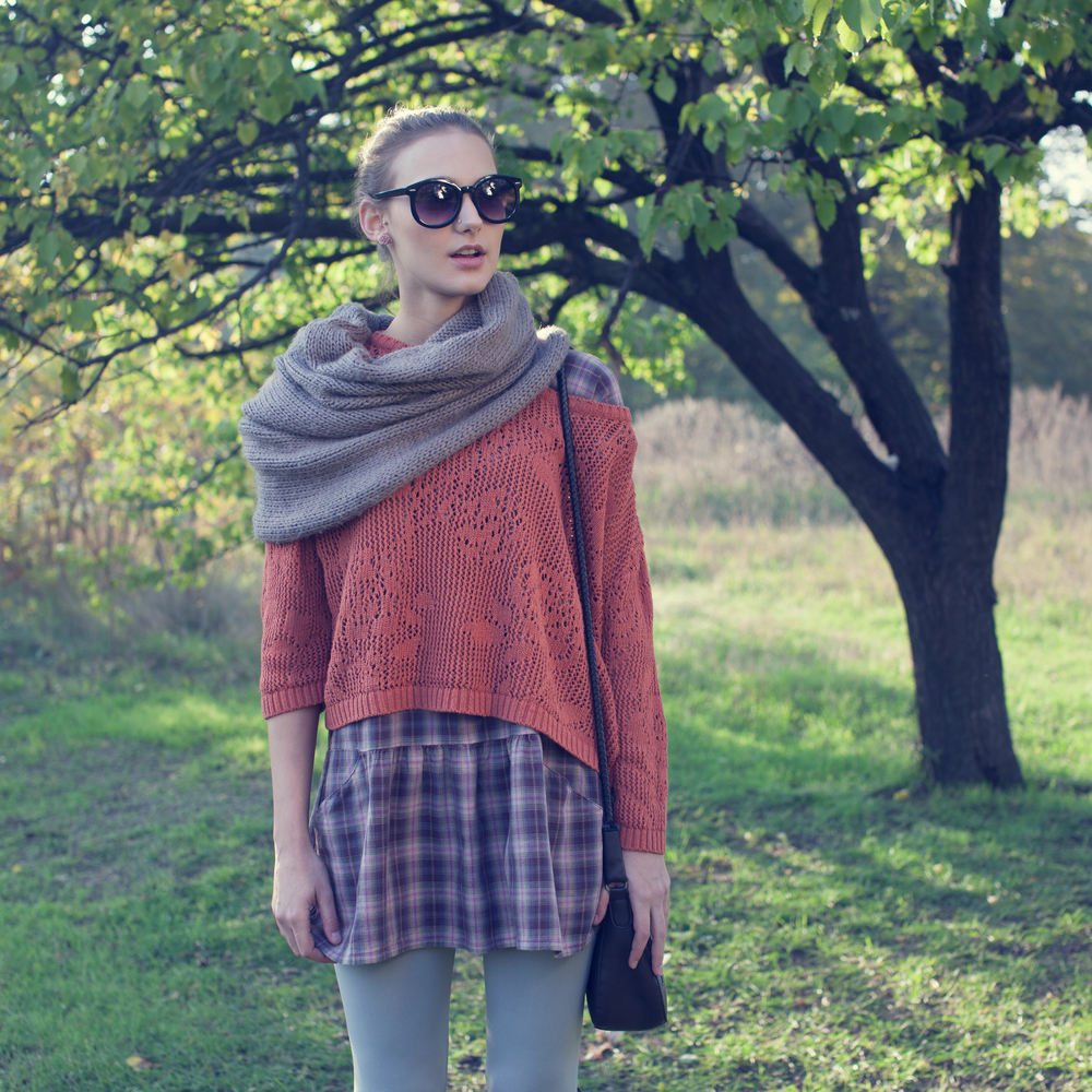 Stylish Woman in Knit Scarf, Sweater & Plaid Skirt