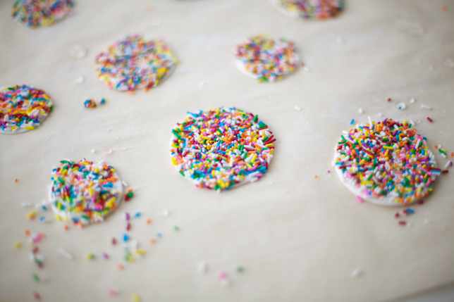 Gum paste dots covered in rainbow sprinkles