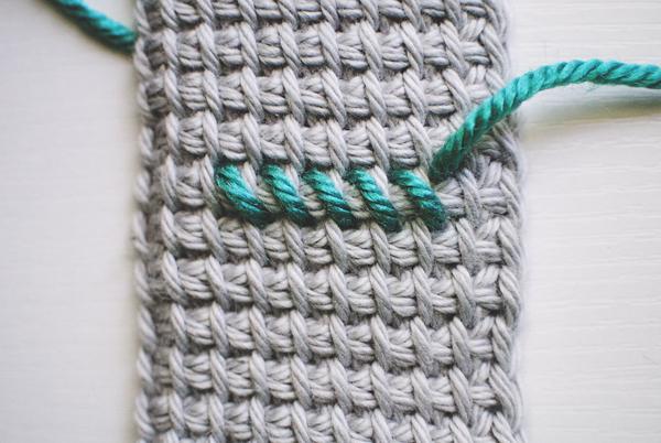 Cross-stitching on Tunisian