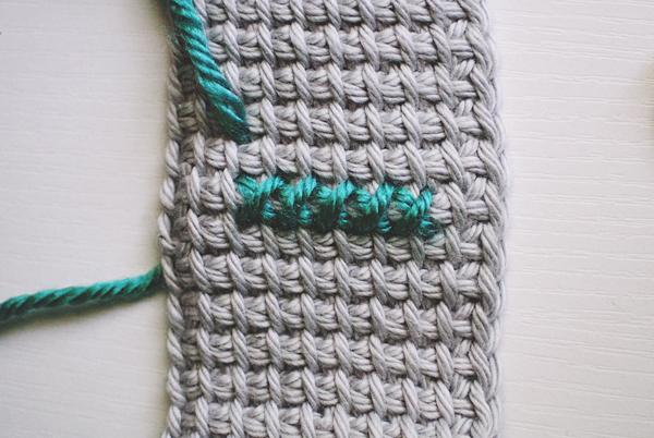 cross-stitching on Tunisian crochet