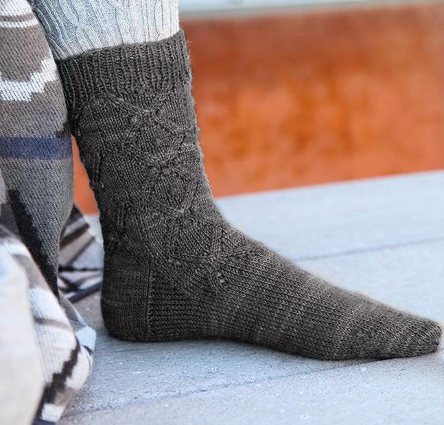 Knit aran counterpane socks
