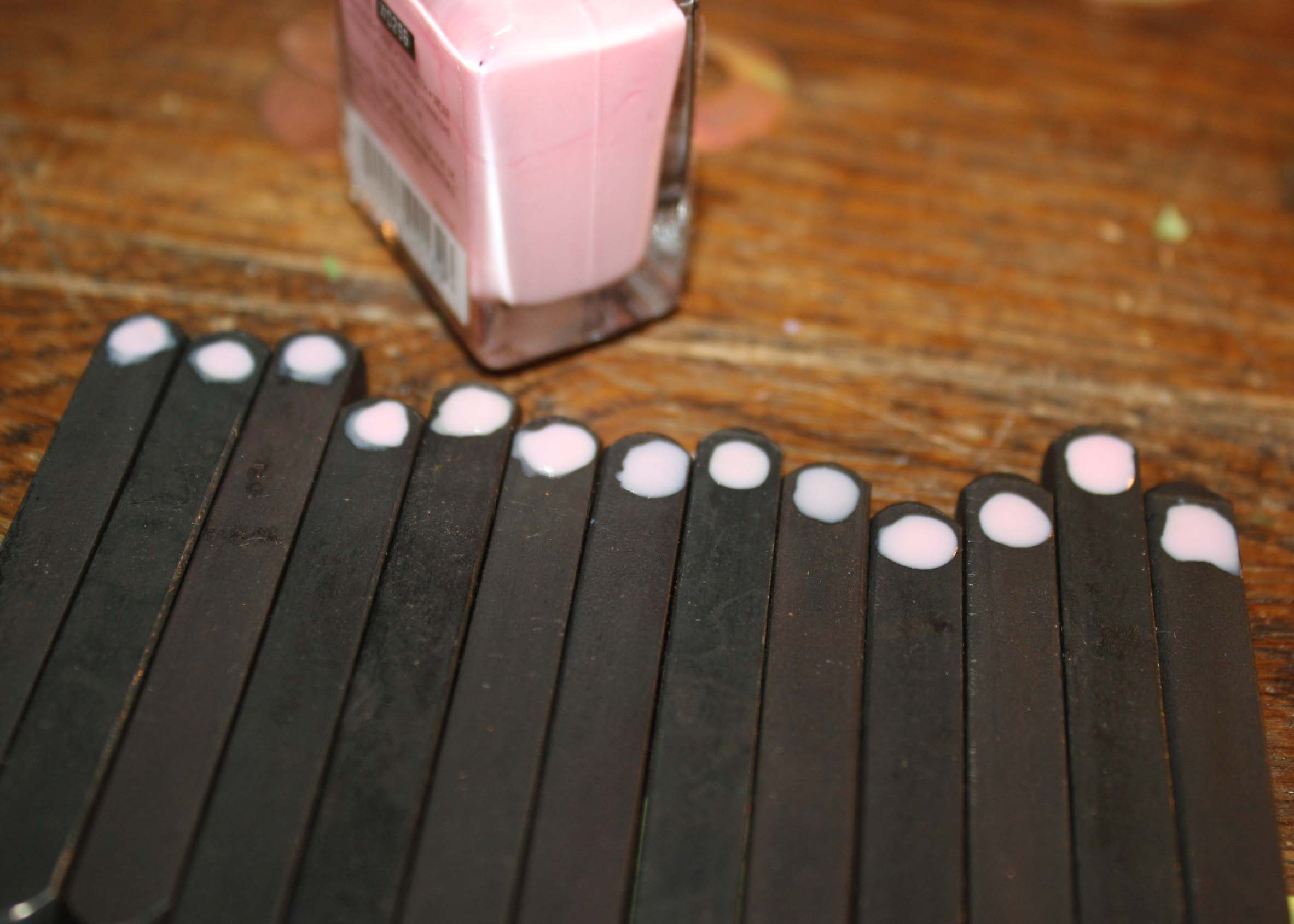 Metal stamps with a dot to label the front of the stamp