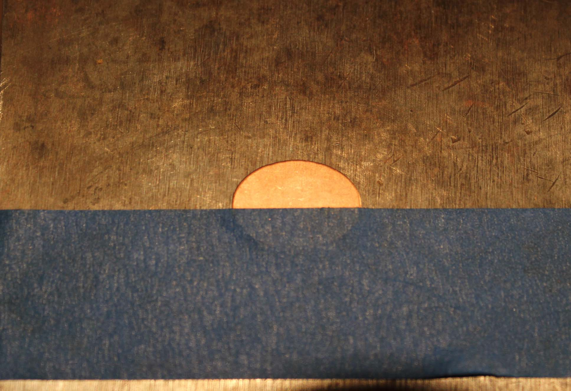 A small oval taped to bench block