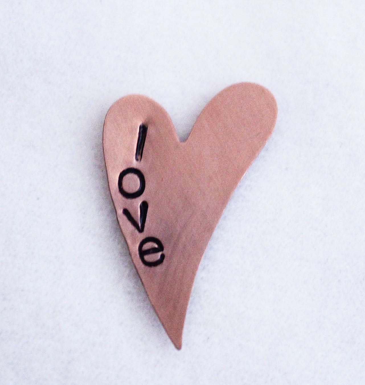 Heart shaped blank handstamped with the word love