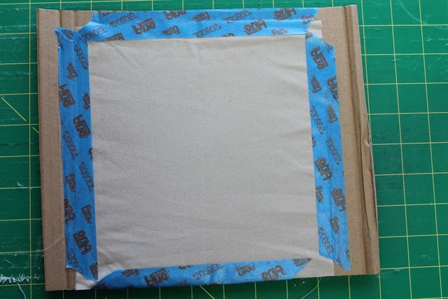 Tape fabric to cardboard.