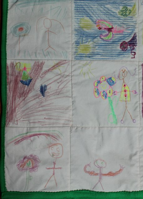Kids make a quilt from crayons