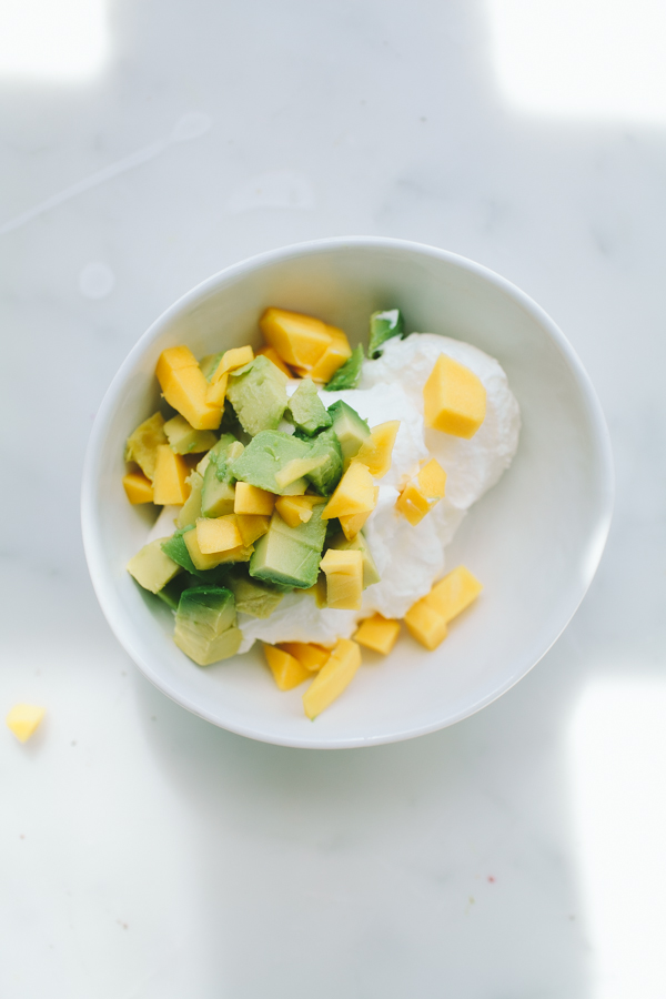 Greek yogurt topped with avocado and mango