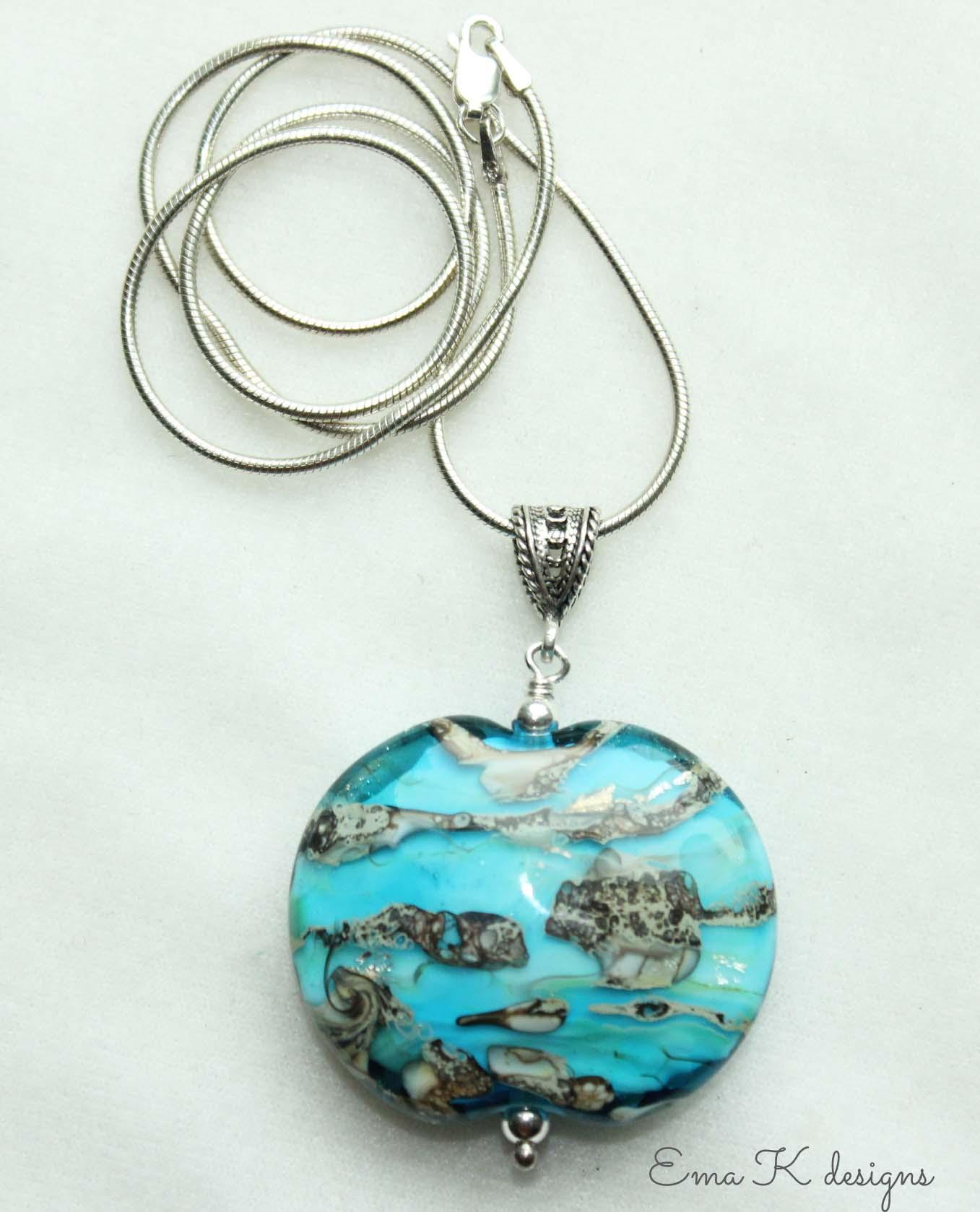 Art bead strung on a silver pendant