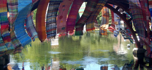 Woven banners hanging from a bridge