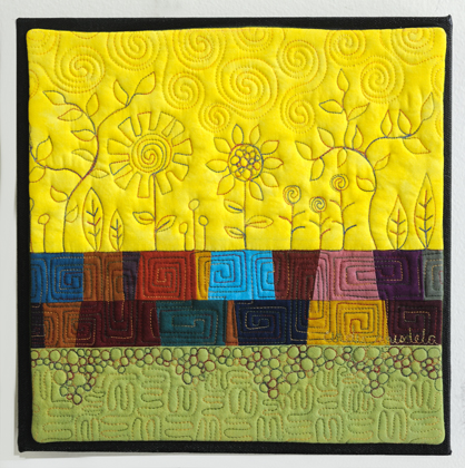 Art Quilt with Stylized Flowers and Pebbles