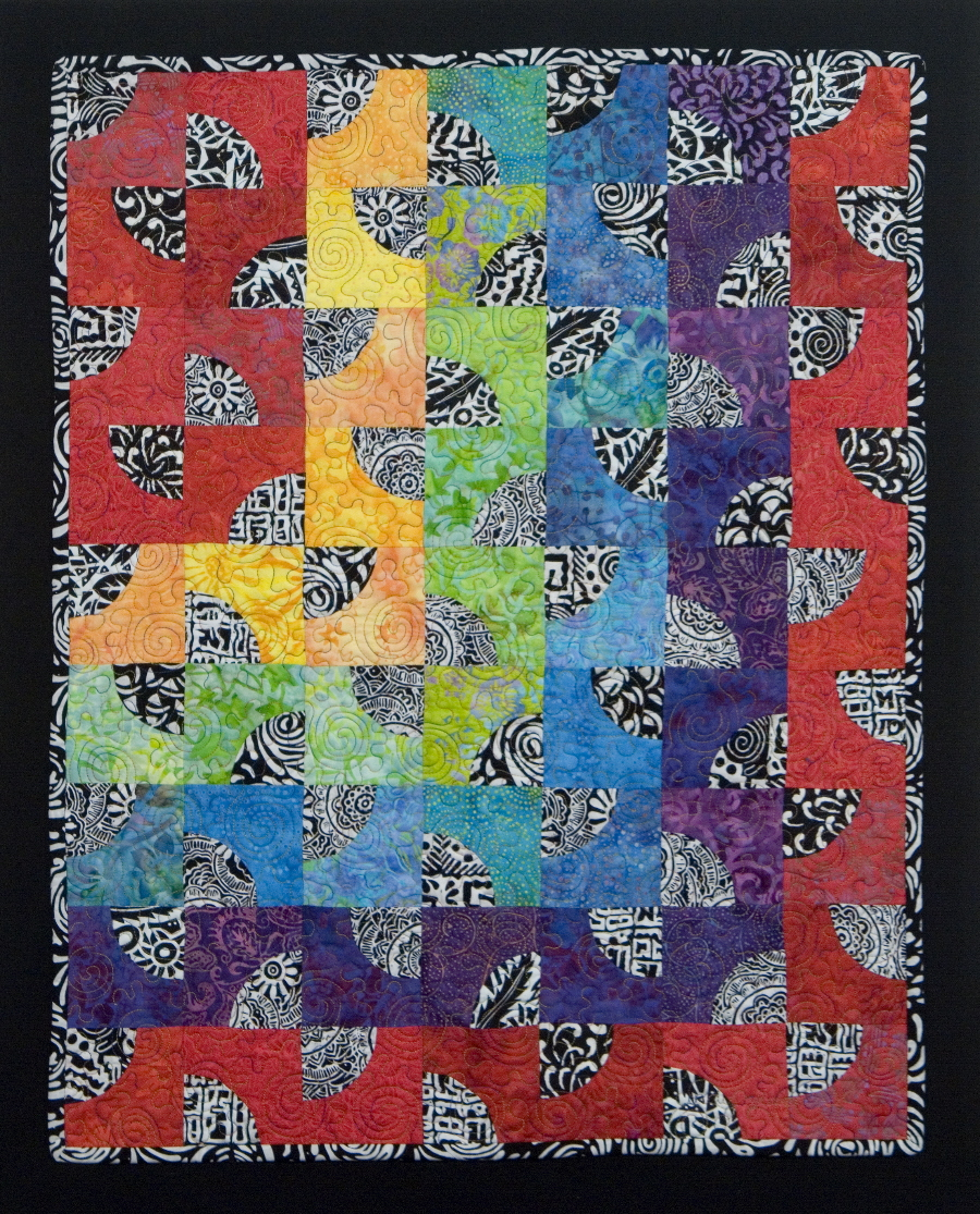 Modern Rainbow Drunkard's Path quilt