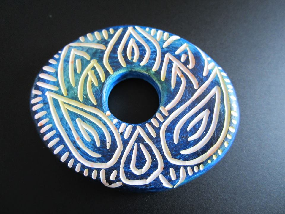Hand carved polymer clay lotus bead by Staci Louise Smith