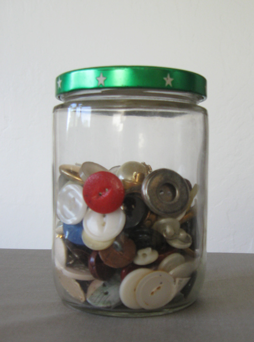 glass jar with buttons