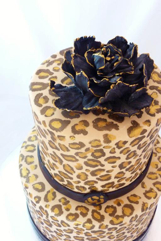 Hand-Painted Cheetah Cake with a Black and Gold Sugar Flower