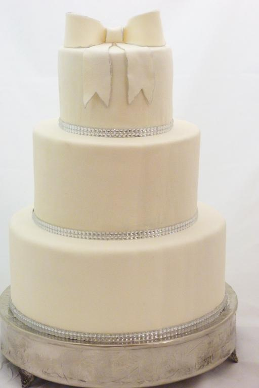 Sweet and Simple Wedding Cake with a White Fondant Bow