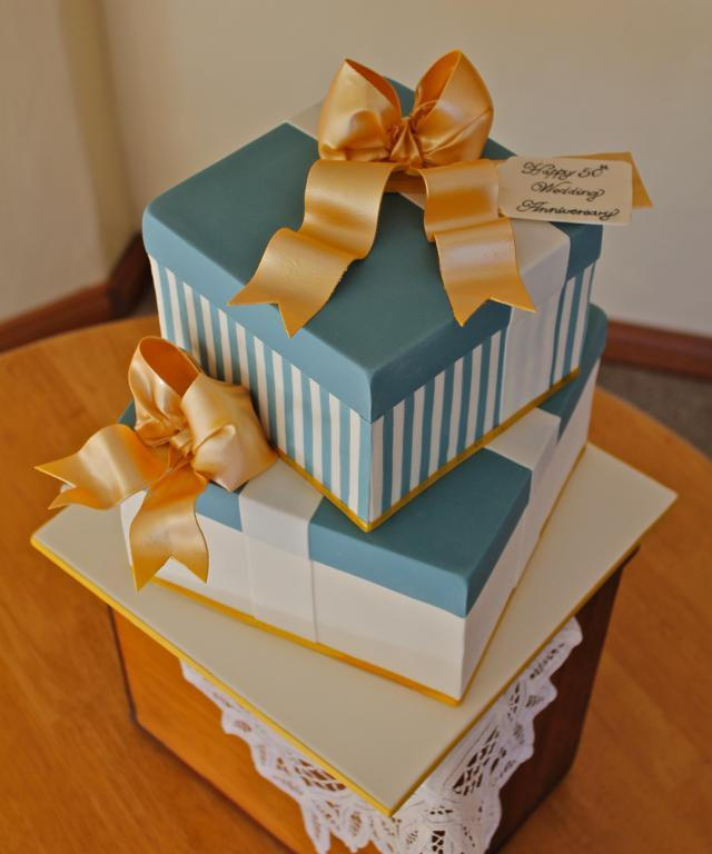Stacked layers of cake resembling gifts