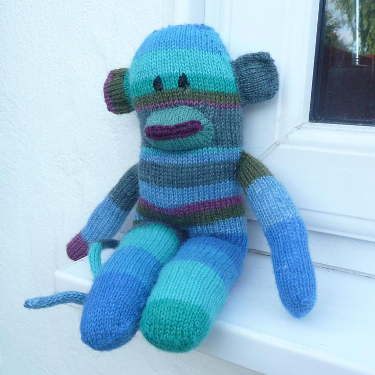 Knitted Sidney the sock monkey doll