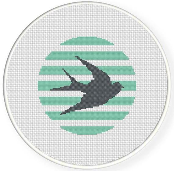 cross stitch pattern of swallow silhouette against stripes