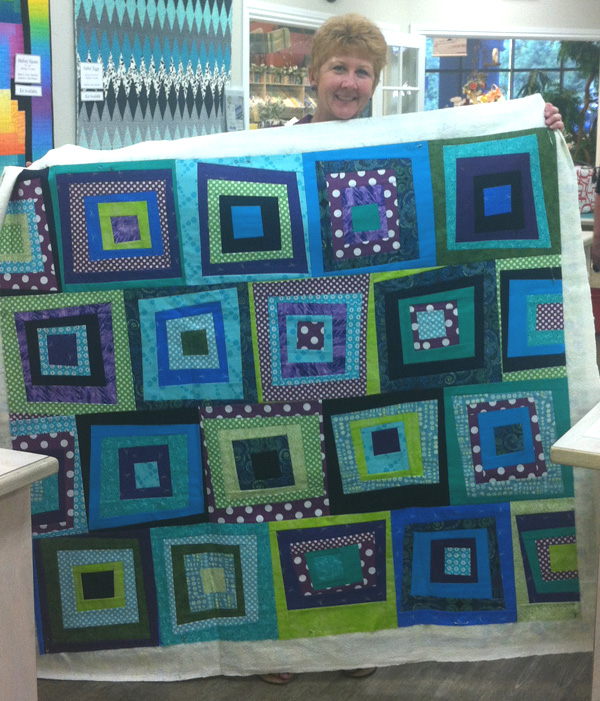 One of my students preparing to machine quilt her Modern Logs quilt