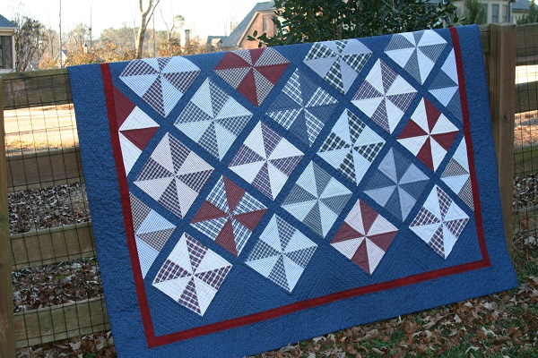 plaid pinwheels quilt with blue borders