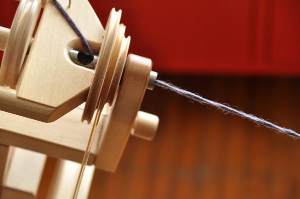 Short draw spinning on a wheel