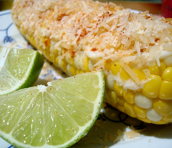 Grilled corn with cheese and lime and chili