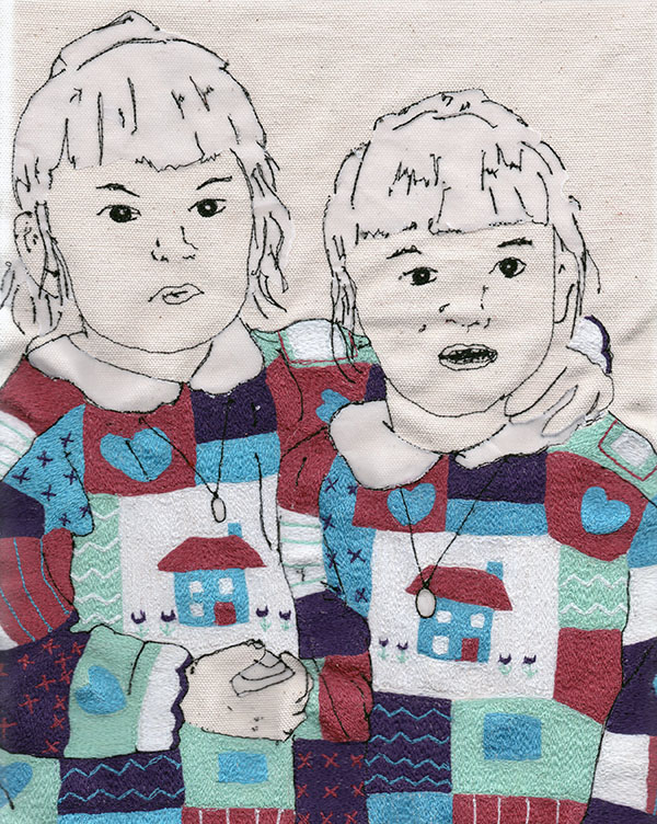 free motion embroidered portrait of twins in knitted jumpers