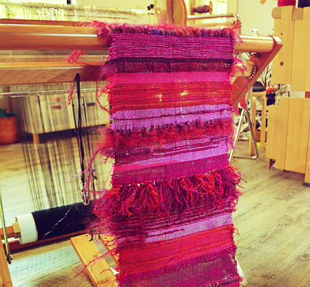 Image of cloth woven with rya knots on a loom
