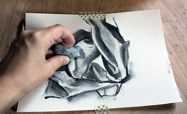 erasing with a kneaded eraser