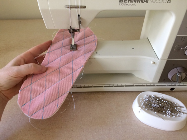 Sewing the grid lines on slippers