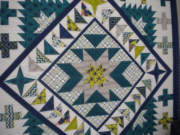 Gorgeous blue and green geometric quilt design