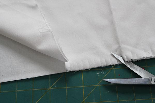 Fringe the edge of the fabric